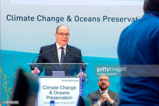 Prince Albert II of Monaco delivers a speech as Belgian Prime Minister Charles Michel listens at a conference on climate change and the state of the...