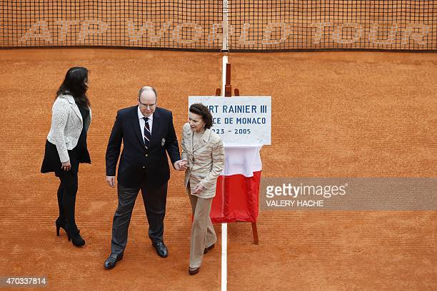 Prince Albert II of Monaco escorts his cousin ElisabethAnne de Massy as her daughter MelanieAntoinette de Massy leaves the court too after the...