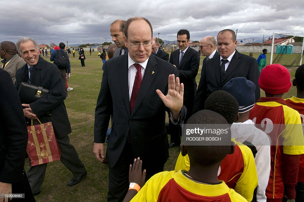 Prince albert ii of monaco gives a hig pictures getty images prince albert ii of monaco gives a high five greeting to a young m4hsunfo