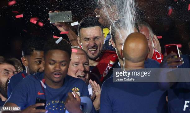Prince Albert II of Monaco, goalkeeper of Monaco Danijel Subasic are showered with champagne during the French League 1 Championship title...