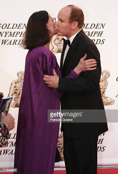 Prince Albert II of Monaco greets french actress Claudine Auger on the red carpet before the closing ceremony of the 46th annual Monte Carlo...