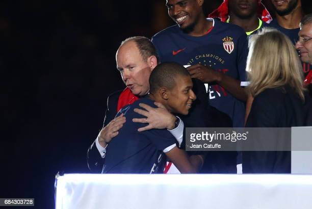 Prince Albert II of Monaco greets Kylian Mbappe of Monaco during the French Ligue 1 Championship title celebration following the French Ligue 1 match...