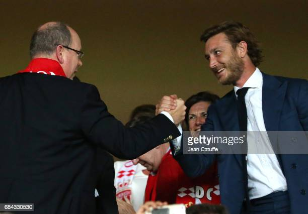 Prince Albert II of Monaco greets Pierre Casiraghi at final whistle to celebrate winning the French Ligue 1 Championship title following the match...
