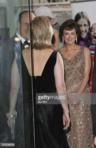 Prince Albert II of Monaco greets Sophie Rhys-Jones, Countess of Wessex as he arrives at the ChildLine & Mission Enfance Royal gala dinner at...