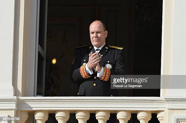 Prince Albert II of Monaco greets the crowd from the Palace's balcony during the Monaco National Day Celebrations on November 19 2015 in Monaco Monaco