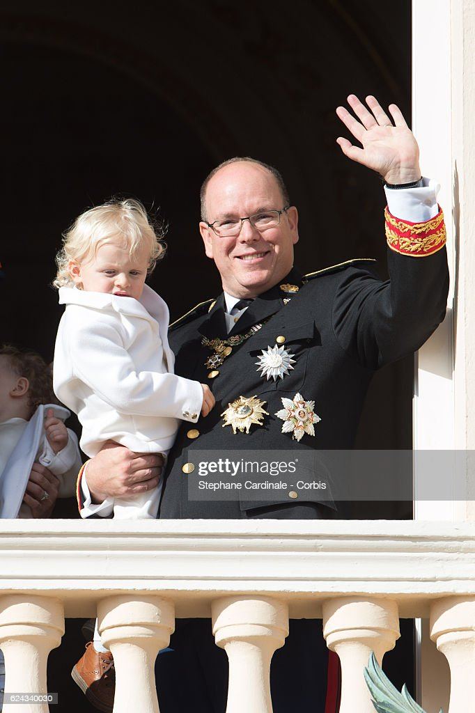 Prince Albert II of Monaco greets the crowd from the palace's balcony with his son Prince Jacques of Monaco during the Monaco National Day Celebrations on November 19, 2016 in Monaco, Monaco.