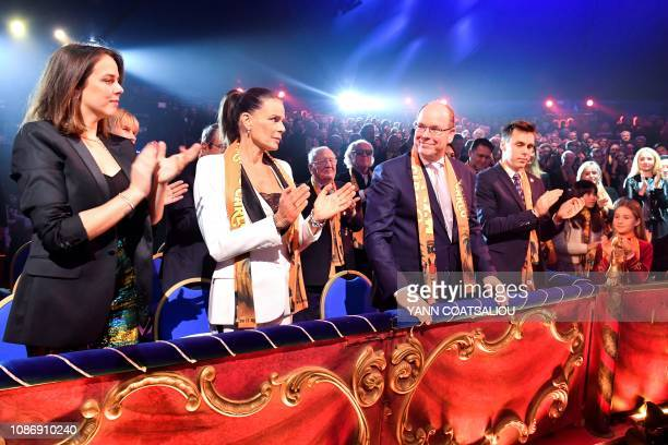Prince Albert II of Monaco his sister Princess Stephanie her daughter Pauline Ducruet and her son Louis Ducruet applaud as they attend the gala of...