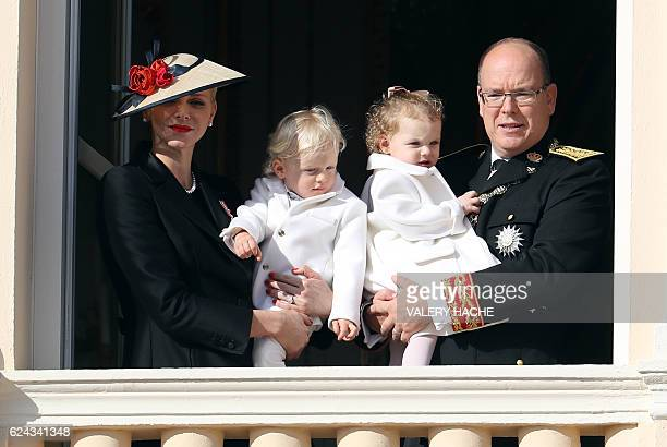 Prince Albert II of Monaco holding Princess Gabriella and princess Charlene of Monaco holding Prince Jacques appear on the balcony of the Monaco...