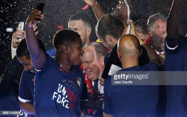 Prince Albert II of Monaco is showered with champagne during the French League 1 Championship title celebration following the French Ligue 1 match...