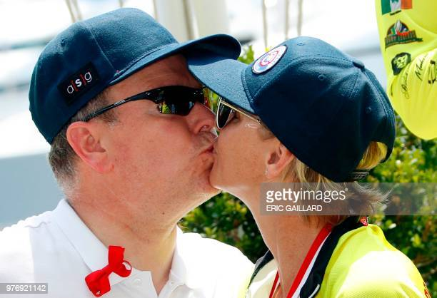 Prince Albert II of Monaco kisses his wife Princess Charlene of Monaco after she won with her team the Riviera Water Bike Challenge in support of the...