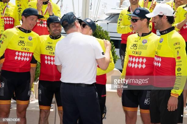 Prince Albert II of Monaco kisses Princess Charlene of Monaco as her winning team members David TannerChristophe Dominici Terence Parkin and Mark...