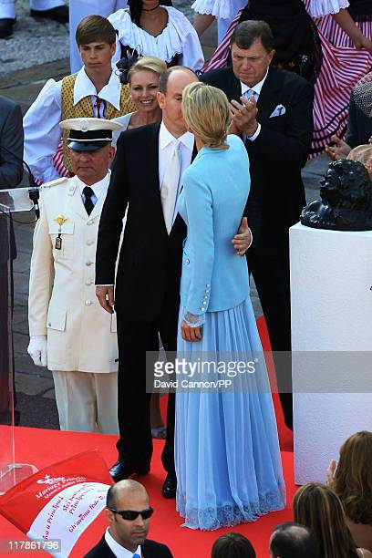 Prince Albert II of Monaco kisses Princess Charlene of Monaco in front of well wishers after the civil ceremony of their Royal Wedding at the...