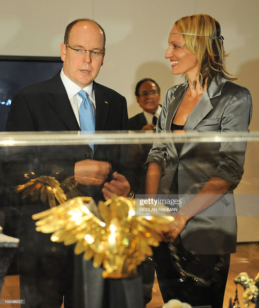 Prince Albert II (L) of Monaco looks at : News Photo