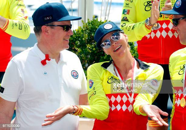 Prince Albert II of Monaco looks at Princess Charlene after she won with her team the Riviera Water Bike Challenge in support of the Princess...