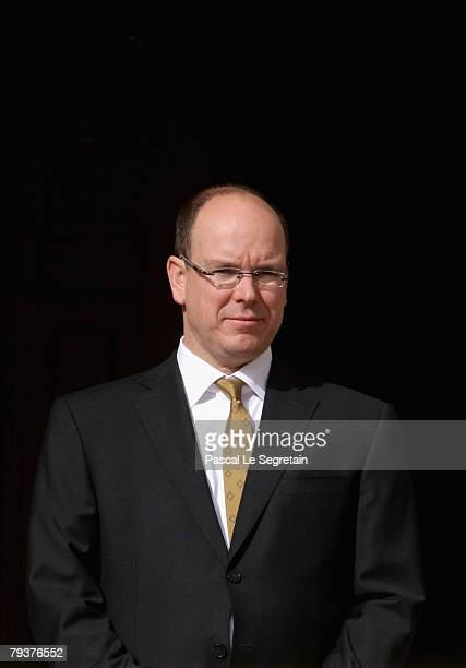 Prince Albert II of Monaco looks on the religious parade passing by the Royal Palace Square during the annual Sainte Devote celebration Monaco's...