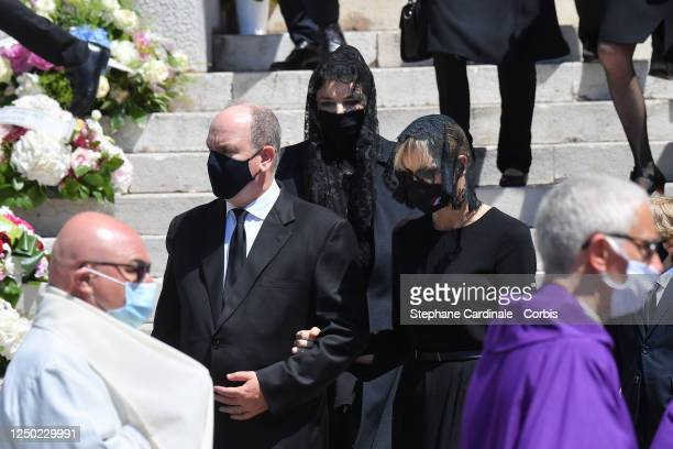 Prince Albert II of Monaco Melanie Antoinette de Massy and Princess Charlene of Monaco leave the Monaco Cathedral after ElizabethAnn De Massy's...