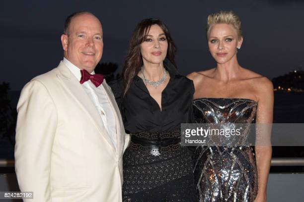 Prince Albert II of Monaco Monika Bellucci and Princess Charlene of Monaco attend the 69th Monaco Red Cross Ball Gala at Sporting MonteCarlo on July...