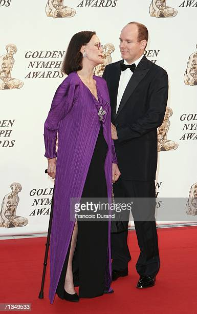 Prince Albert II of Monaco pose with french actress Claudine Auger on the red carpet before the closing ceremony of the 46th annual Monte Carlo...