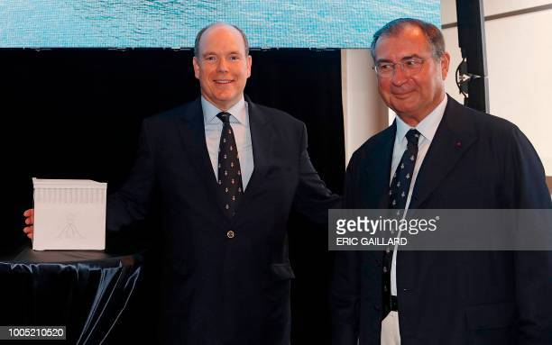 Prince Albert II of Monaco poses alongside Martin Bouygues Chairman and Chief Executive Officer of French industrial and telecoms conglomerate...