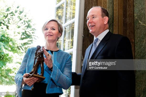Prince Albert II of Monaco poses next to Bordeaux Deputy Mayor Virginie Calmels during a visit at the city hall of Bordeaux on July 5 2017 / AFP...