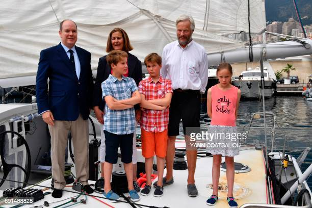 Prince Albert II of Monaco poses onboard of The Oceano Scientific Explorer Boogaloo with Oceano Scientific Association President Cecile...