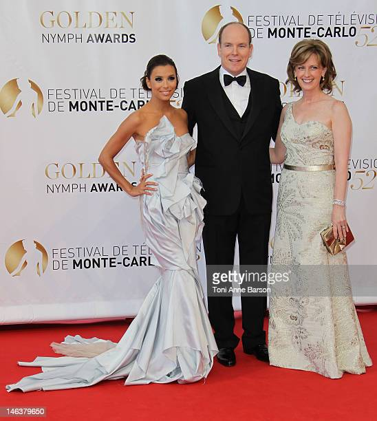 Prince Albert II of Monaco poses with actress Eva Longoria and Anne Sweeney as they arrive at the Golden Nymph Award during the 52nd Monte Carlo TV...
