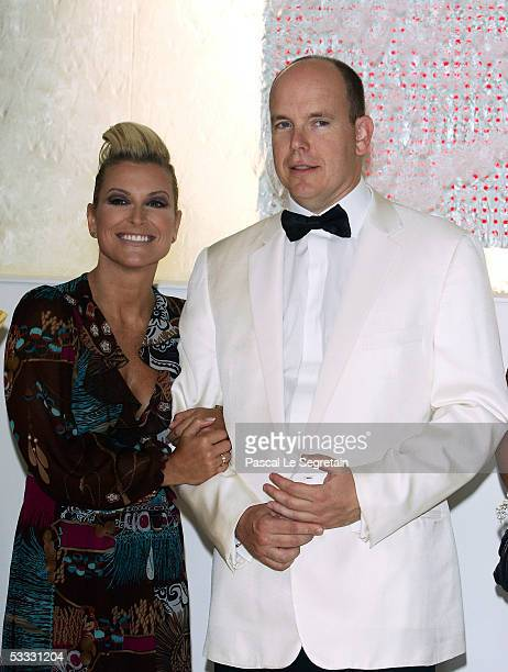 Prince Albert II of Monaco poses with American Singer Anastacia at the 57th Red Cross Ball on August 5 2005 in Monte Carlo Monaco