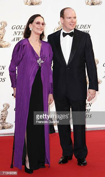 Prince Albert II of Monaco poses with french actress Claudine Auger on the red carpet before the closing ceremony of the 46th annual Monte Carlo...