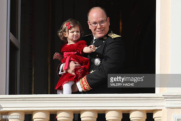 Prince Albert II of Monaco poses with India Casiraghi on the balcony of the Monaco Palace during the celebrations marking Monaco's National Day, on...