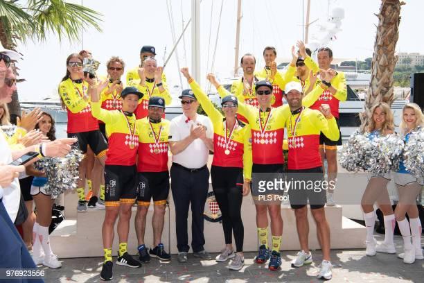 Prince Albert II of Monaco poses with the Winning team David TannerChristophe Dominici Princess Charlene of Monaco Terence Parkin and Mark Webber...