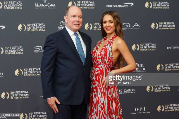 Prince Albert II of Monaco poses with US actress Jessica Alba during a photocall as they arrive for the opening ceremony of the 59th MonteCarlo...