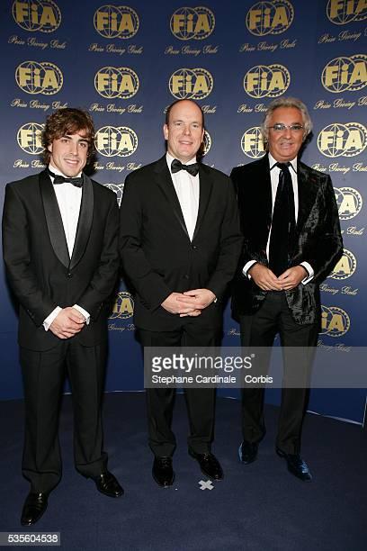 Prince Albert II of Monaco poses with world champion driver, Fernando Alonso and manager Flavio Briatore at the FIA gala held in Monaco.