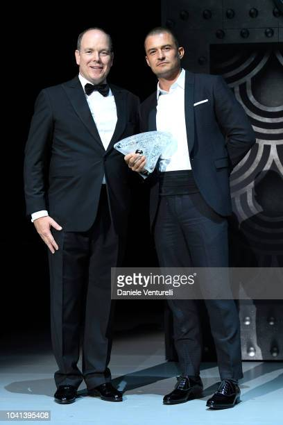 Prince Albert II of Monaco presents Orlando Bloom with Prince Albert II of Monaco Foundation award on stage at the Gala for the Global Ocean hosted...