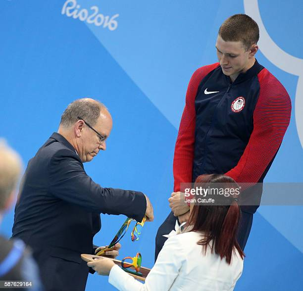 Prince Albert II of Monaco presents the gold medal to Ryan Murphy of USA during the swimming finals on day 3 of the Rio 2016 Olympic Games at Olympic...
