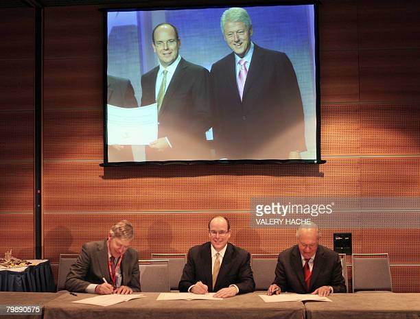 Prince Albert II of Monaco President of Club of Madrid Chilean Ricardo Lagos and US Timothy EWirth from the UN Foundation sign an agreement for...