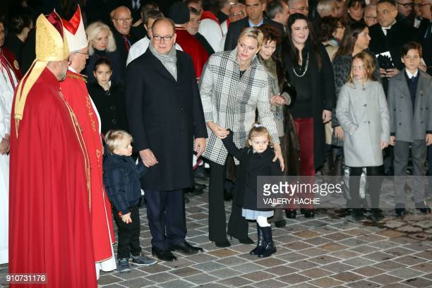 Prince Albert II of Monaco Prince Jacques Princess Charlene and Princess Gabriella arrive for the 'SainteDevote' procession on January 26 2018 in...