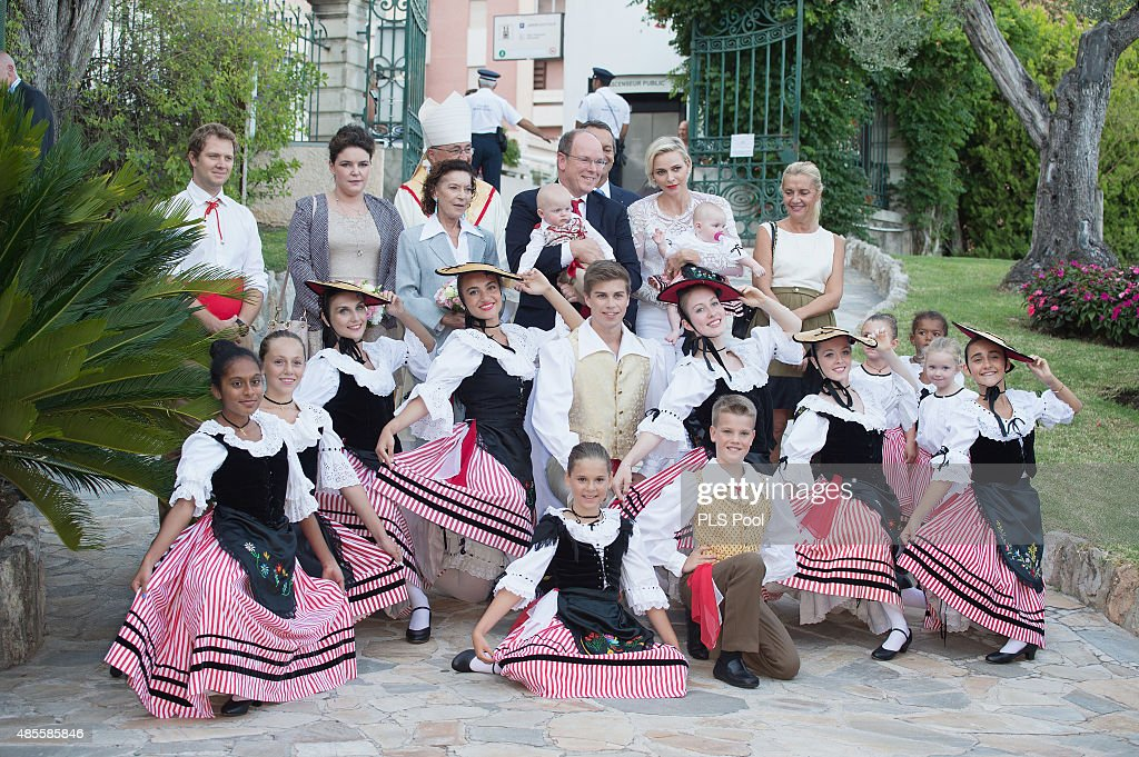 Prince Albert II of Monaco, Prince Jacques, Princess Charlene of Monaco and Princess Gabriella pose with dancers wearing traditional costumes during the annual traditional 'Pique Nique Monegasque' on August 28, 2015 in Monaco, Monaco.