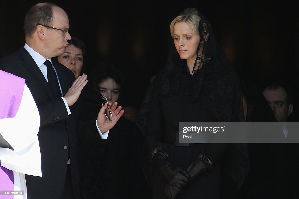 Prince Albert II of Monaco, Princess Caroline of Hanover and Charlene Wittstock attend the funeral of Princess Melanie-Antoinette at Cathedrale Notre-Dame-Immaculee de Monaco on March 24, 2011 in Monaco, Monaco. ((Photo by Pool/Getty Images))