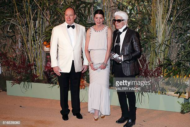 Prince Albert II of Monaco Princess Caroline of Hanover and fashion designer Karl Lagerfeld arrive for the annual Rose Ball at the MonteCarlo...