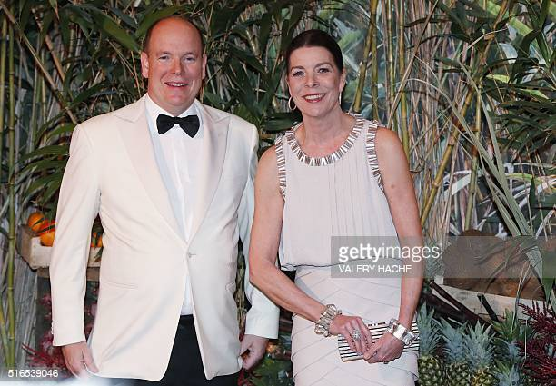 Prince Albert II of Monaco Princess Caroline of Hanover arrive for the annual Rose Ball at the MonteCarlo Sporting Club in Monaco on March 19 2016...