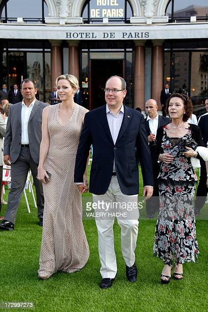 Prince Albert II of Monaco , Princess Charlene and Elisabeth Anne de Massy attend a ceremony marking the 150th anniversary of the SBM on July 5, 2013...
