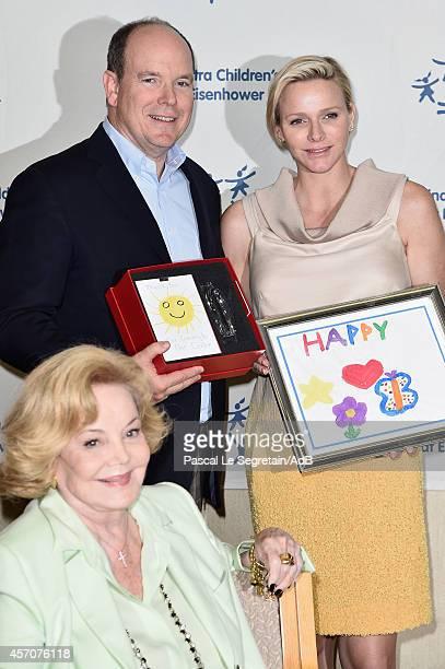 Prince Albert II of Monaco, Princess Charlene of Monaco and Barbara Sinatra attend a visit to the Barbara Sinatra Children's Center on October 11,...