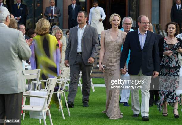 Prince Albert II of Monaco Princess Charlene of Monaco and Elisabeth Anne de Massy attend the party in celebration of the SBM 150th Anniversary on...