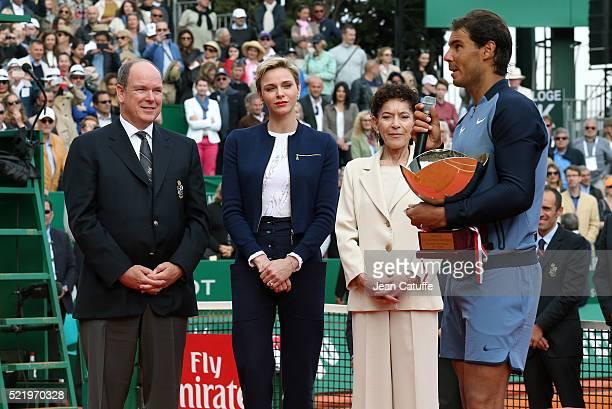 Prince Albert II of Monaco, Princess Charlene of Monaco and Elisabeth Anne de Massy look on as Rafael Nadal of Spain speaks to the crowd with the...