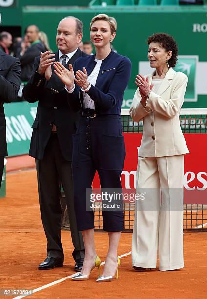 Prince Albert II of Monaco, Princess Charlene of Monaco and Elisabeth Anne de Massy applaud after the singles final match between Rafael Nadal of...