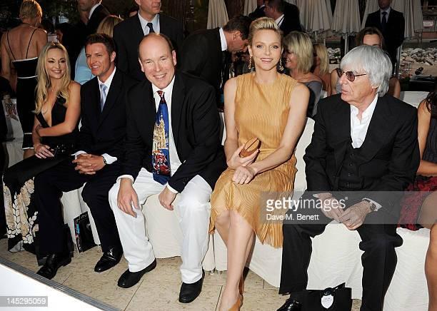 Prince Albert II of Monaco Princess Charlene of Monaco and F1 Supremo Bernie Ecclestone attend a cocktail reception during Amber Lounge Fashion...