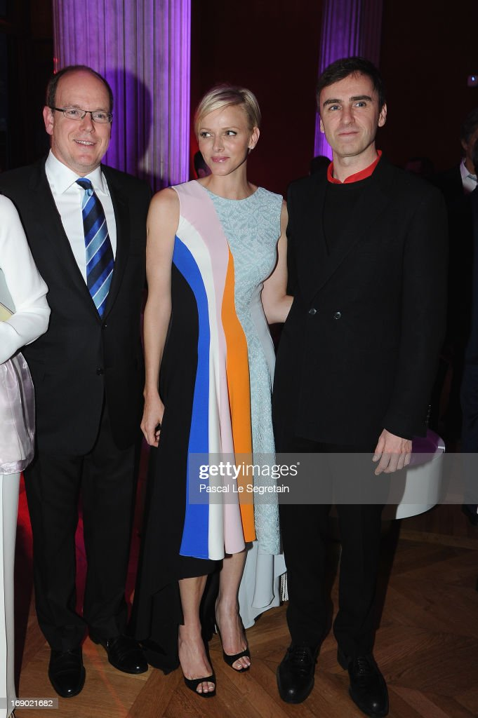 Prince Albert II of Monaco, Princess Charlene of Monaco and fashion designer Raf Simons attend the Dior Cruise Collection 2014 cocktail on May 18, 2013 in Monaco, Monaco.