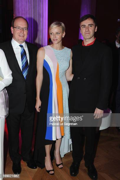 Prince Albert II of Monaco Princess Charlene of Monaco and fashion designer Raf Simons attend the Dior Cruise Collection 2014 cocktail on May 18 2013...