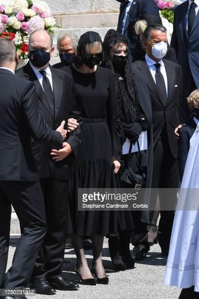 Prince Albert II of Monaco Princess Charlene of Monaco and Melanie Antoinette de Massy leave the Monaco Cathedral after ElizabethAnn De Massy's...