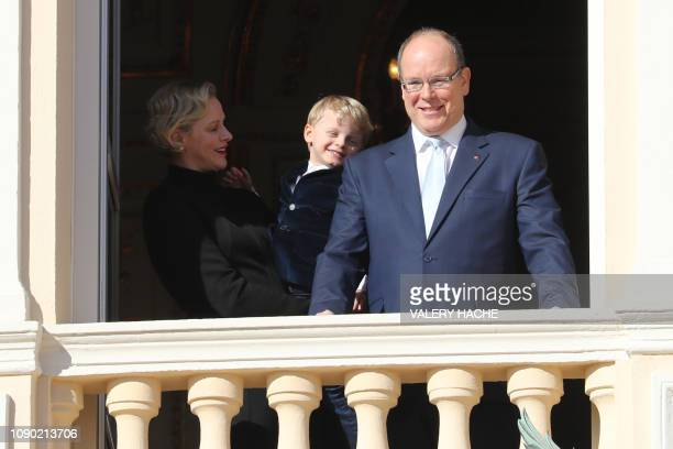 Prince Albert II of Monaco, Princess Charlene of Monaco and Prince Jacques appear on the palace's balcony during Sainte Devote Celebrations in Monaco...